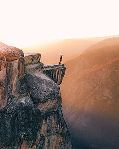 man standing on cliff photo
