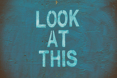 'Look at this' stencil letteringon an urban wall