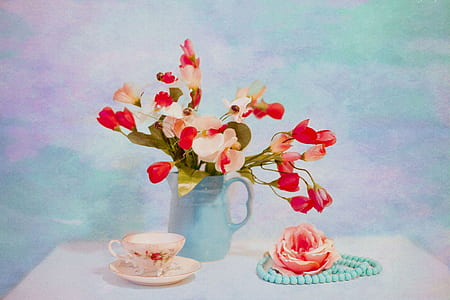 red and white flowers in green vase near white teacup still life painting