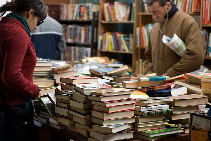 people staring at books