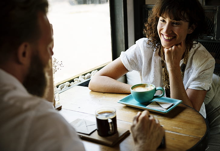 man and woman dating while smiling at eachother