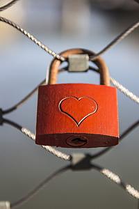 bokeh shot of orange and brown heart-printed padlock