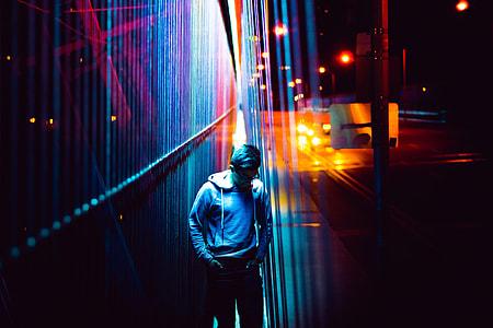Man in city lights at night