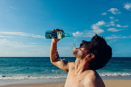 time lapse photography of man drinking beverage