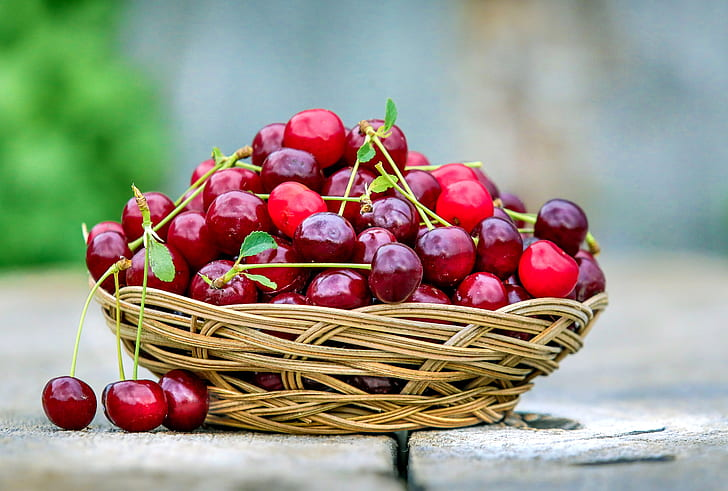 red cherry on brown wicker basket