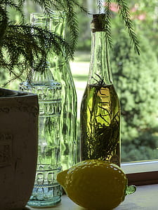 clear glass bottle with liquid
