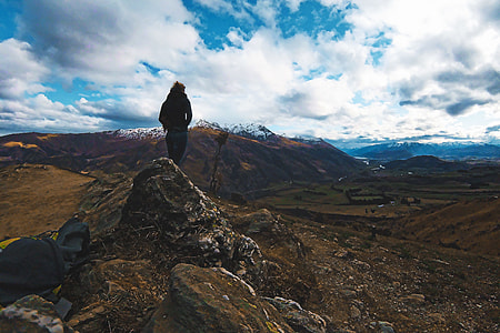 Person viewing the mountains in New Zealand