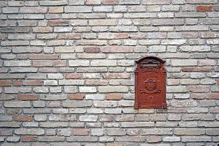 rectangular brown wooden mailbox door art