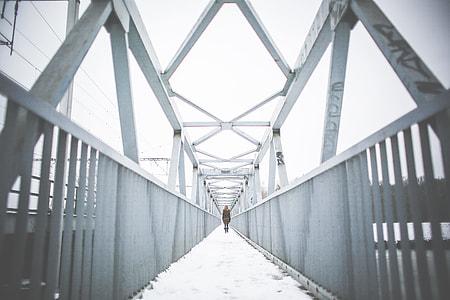 Girl Walking on Steel Bridge in Winter