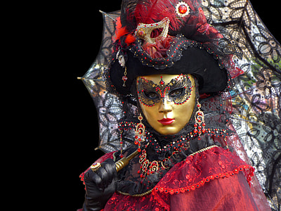 woman wearing red and black dress and gold-colored mask