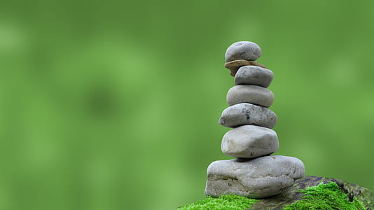 focal focus photography of stack of gray stones