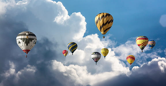 hot air balloons fly on sky