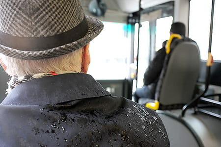 Man Wearing Black Coat While Wet