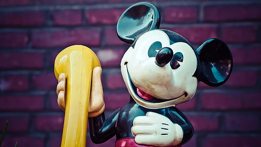 Mickey Mouse holding yellow telephone