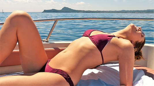 woman in maroon bra and pantie on yacht