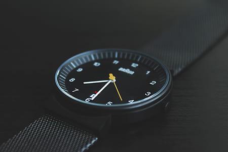 round black analog watch with black strap