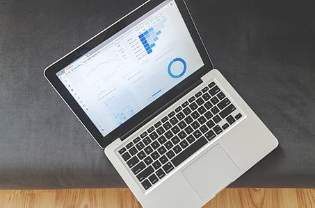 MacBook Pro on black suede textile