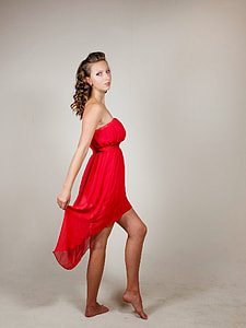 woman in red strapless high-low dress