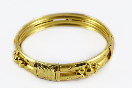 gold-colored floral bangle