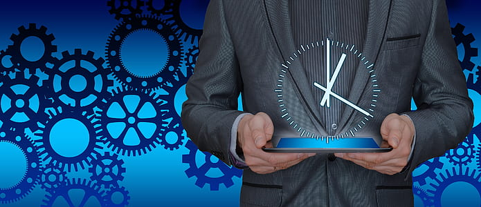 person holding blue base clock