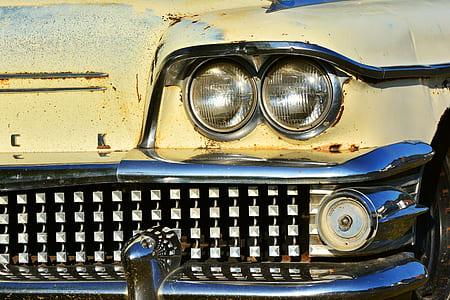 closeup photography of classic yellow car