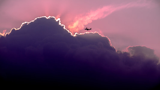silhouette of airliner at sunset
