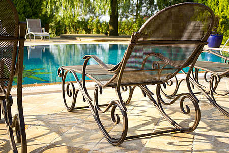 brown wooden lounge chair