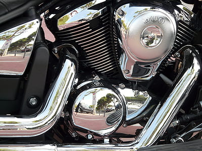 closeup photo of chrome motorcycle engine