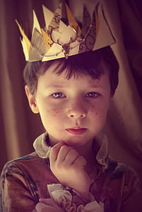 boy in brown collared ruffled top with crown portrait photo