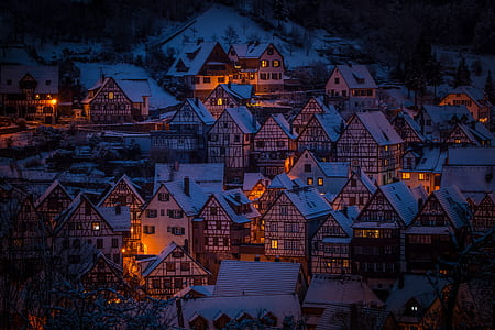 assorted houses with orange lights during daytime