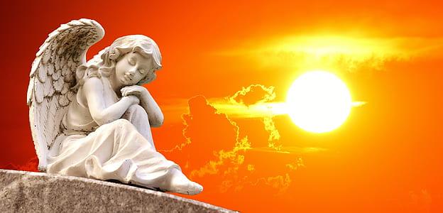 white ceramic lady angel figurine with sunset background