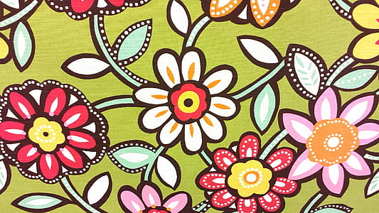 green and multicolored floral textile