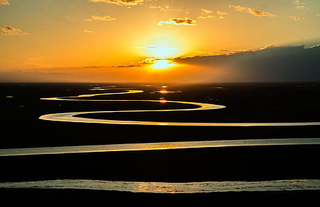 Large Body of Water Stream during Dawn