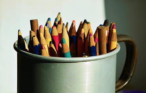 assorted color pencil on grey mug