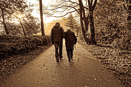 couple walking along concrete pathway