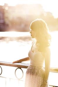 woman wearing white spaghetti strap dress