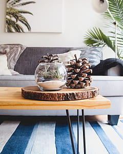 brown wooden table with decor on top