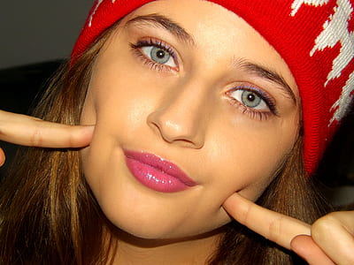 close shot of woman wearing red and white knit cap
