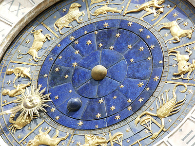 closeup photo of gold and brown zodiac signs embossed structure