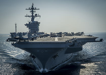 gray aircraft carrier in sea