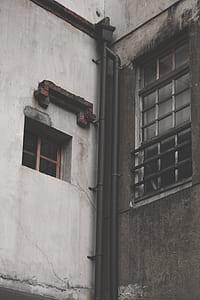 photo of black tubes on gray concrete wall