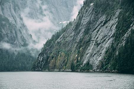 rock mountain formation beside sea