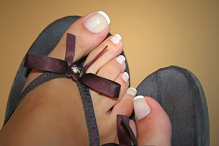 person wearing black pair of flip-flops