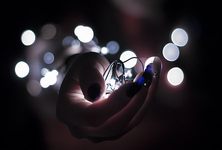 person holding string light