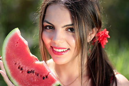 female holding watermelon