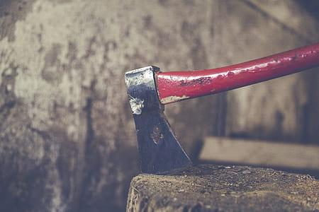 red handled ax closeup phott