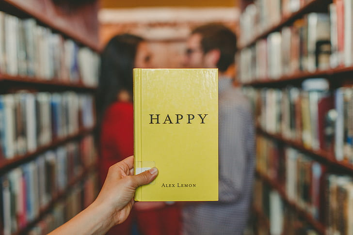 selective focus of Happy book by alex Lemon