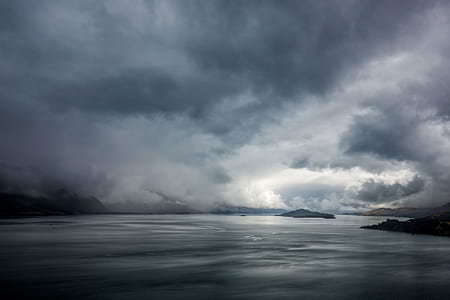 clouds above body of water