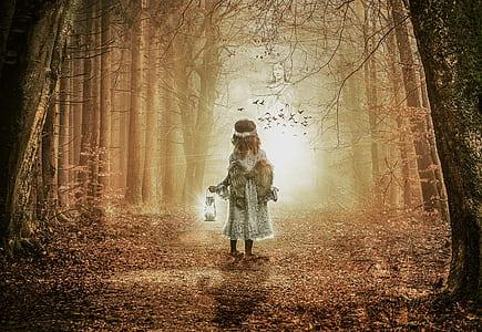 angel holding lantern painting