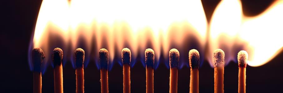 lighted match sticks
